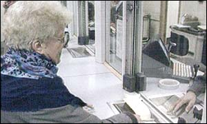 Pensioner collecting her pension from Post Office