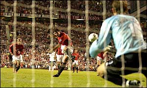 Van Nistelrooy earns a debatable penaly after being tuged back by Ugo Ehiogu