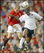 Joseph Desire-Job and Phil Neville leap for the ball