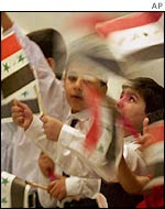 Iraqi children wave Iraqi flags