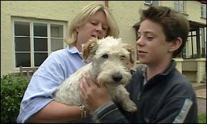 Wellie, the wire-haired terrier and his original owners