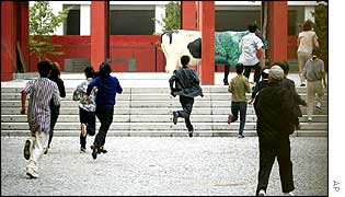 North Koreans run towards school