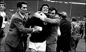 Scotland's Jim Baxter is mobbed by fans after the 1967 win over England