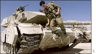 Israeli soldier on a tank