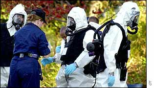 Hazardous materials crews prepare to enter US Senate offices last October