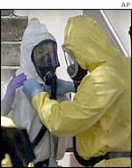 Biohazard crews remove their gear after examining a building in Florida looking for clues to last year's anthrax attacks