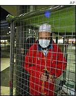 Mehdi Ghazali in his cage in Sergels Torg square in central Stockholm