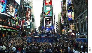 A crowded Times Square watches Bon Jovi