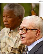 Nelson Mandela (left) and Tariq Aziz