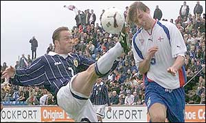 Paul Dickov challenges against Jon Roi Jacobsen