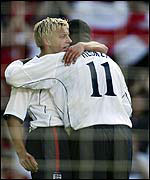 Smith is congratulated by Heskey