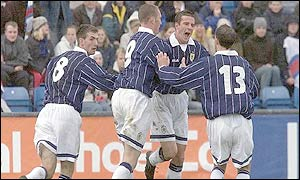 Barry Ferguson celebrates his equaliser against the Faroe Islands