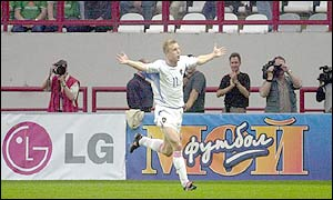 Vladimir Beschastnykh celebrates after scoring Russia's second goal