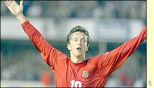 Simon Davis celebrating scoring the second goal for Wales