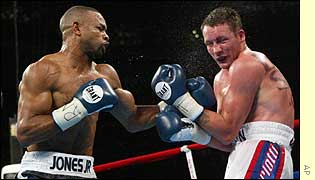 World light-heavyweight champion Roy Jones retained his WBC, IBF and WBA titles against Britain's Clinton Woods
