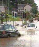 Vehicles on flooded road