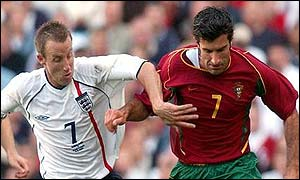 Lee Bowyer battles with Portugal's Luis Figo