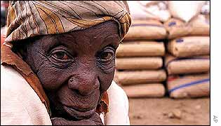 Zimbabwean woman sits by relief food in the Nhwali area