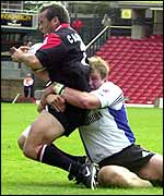 Thomas Castaignede is tackled by Bath's Mike Tindall
