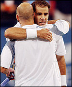 Anadre Agassi hugs Pete Sampras at the net after the latter's victory