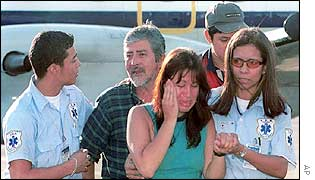 Released hostages Adriana de los Santos and Oscar Hernandez
