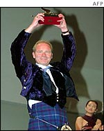 Peter Mullan receiving the Golden Lion at the Venice film festival