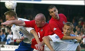 Wales' John Hartson and Andy Melville in the 2-0 win over Finland
