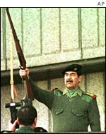 Saddam Hussein fires a rifle to mark the Grand Day of Quds in Baghdad in November 2000