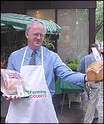National Farmers Union President Ben Gill in an apron at farmers market