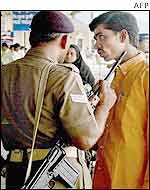 Security personnel checks passenger at Bombay airport