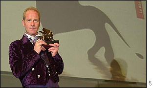 Peter Mullan holds his Golden Lion