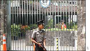 An armed Indonesian police officer stands guard at the gate of the U.S. embassy in Jakarta on Tuesday