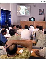 Deputies in Gaza watch the session by video link