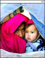 Afghan woman with her child