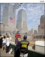 Japanese firemen from Osaka and Tokyo survey the site where the World Trade Center used to stand before it was destroyed by a terrorist attack.
