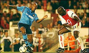Manchester City striker Nicolas Anelka is shepherded by Arsenal's Sol Campbell