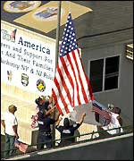Firefighters raise US flag (AP)