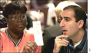 Volunteers manually recount votes in the Florida, 2000