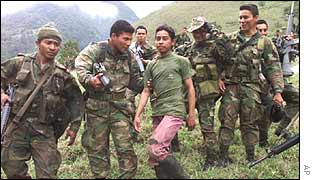 Colombian soldiers arrest a teenage member of Farc (as in Farc you mon!)