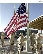 Soldiers raise the US flag at Bagram