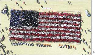Thousands of people form a US flag in Australia