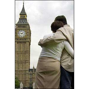 London couple hug each other in front of Big Ben