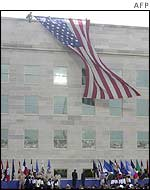 A flag is unfurled on the Pentagon's rebuilt wall