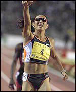 Ana Guevara points to the crowd after winning another Golden League 400m