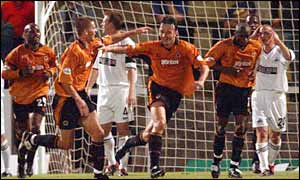 Wolves' Ludovic Pollet (centre) wheels away after making it 2-2 against Swansea