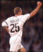 Jamie Wood celebrates after scoring Swansea's second goal against Wolves
