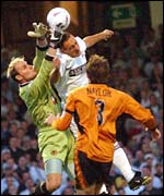 Swansea's Jamie Wood challenges Wolves keeper Michael Oakes