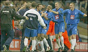 Clinton Morrison (centre) is mobbed after his late equaliser