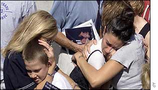 Mourners console each other at Ground Zero
