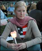 New Yorker Tuesday Burns holds a candle in Central Park